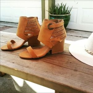 Tan wedge sandals with ankle cutouts